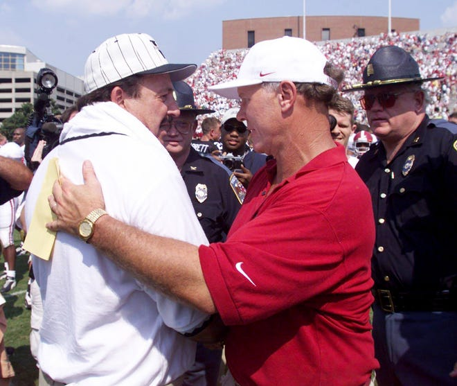 Vanderbilt head coach Woody Widenhofer, left, shakes hands with Alabama Coach Mike DuBose after the game Sept. 4, 1999.