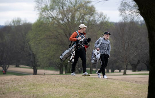 Keylan Myers, left, and Callie Edwards enjoy a round of golf at McCabe Golf Course in Nashville on March 23, 2020.