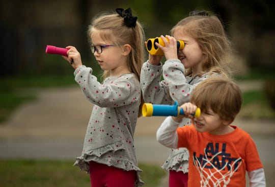 wins Savannah and Josephine Hurt, 5, and their brother James Hurt, 3, search for stuffed bears in the windows of homes in the Stewart Springs subdivision Monday, March 23, 2020, in Murfreesboro, Tenn.