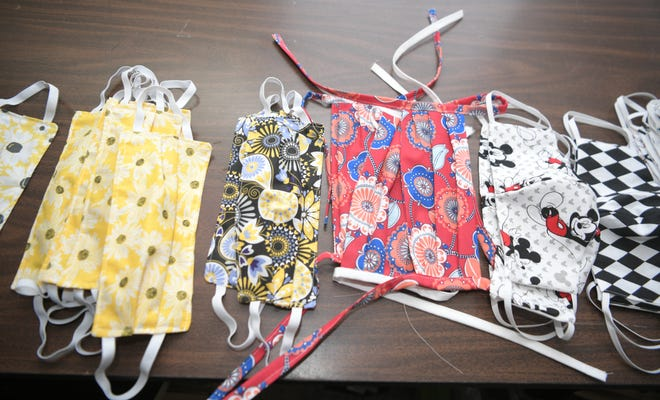 Professional seamstress Doris McMillan and others have made cotton face masks for healthcare workers at Williamson County Medical Center on Monday, March 23, 2020.  The face mask have a slit so workers can place a filter inside the mask.