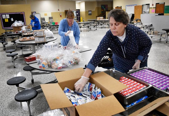 Barbara Rice helps put together breakfast and lunch packages to distribute to students in Watertown, Tenn. Monday, March 23, 2020. Wilson County Schools will be providing two-day meal packages for pickup for children 18 years or younger while schools are closed due to the coronavirus outbreak.