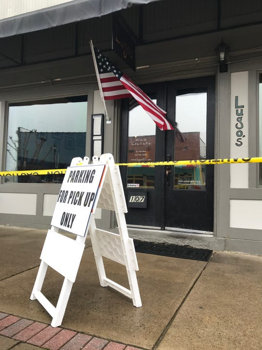 """The City of Dickson recently set up """"Parking for Pick Up Only"""" signs in front of parking spaces near restaurants and bars on Main Street following the governor's  order Sunday."""