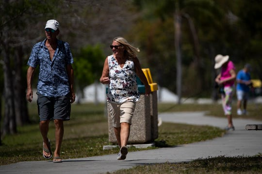 Carmine and Amy Cannizzoro of East Naples enjoy the day with a walk., Monday, March 23, 2020, at Sugden Regional Park in East Naples.