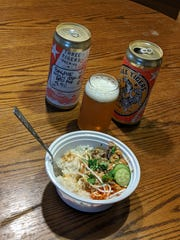 Three Tigers Brewing's Cat Run IPA is paired with a chicken and rice bowl from Mai Chau.