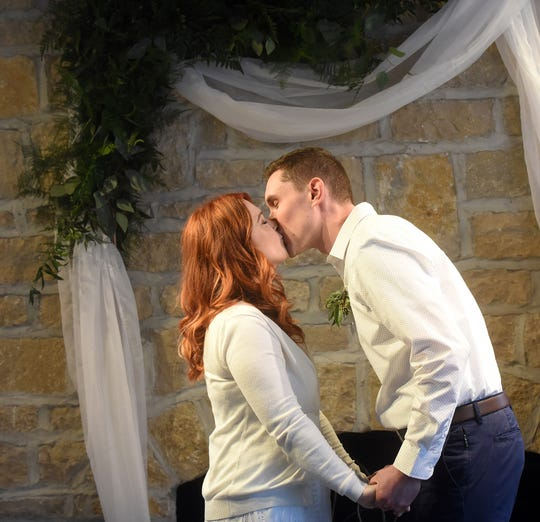 Kate and Bryan Richter kiss for the first time as man and wife during their wedding ceremony on Saturday, March 21, 2020 at their apartment complex's clubhouse. The couple made the difficult decision to postpone their wedding celebration to September in response to the coronavirus outbreak.