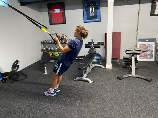 USA women's soccer player Carli Lloyd working out at her home.