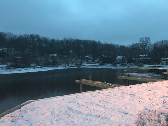 Snow coats the shore line at Upper Greenwood Lake clubhouse in West Milford March 23, 2020.