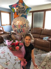 Renata Giordano, 8, was surprised on her birthday by community members with a small parade complete with signs, balloons, honking horns and police sirens after she had to cancel her birthday party because of the coronavirus.