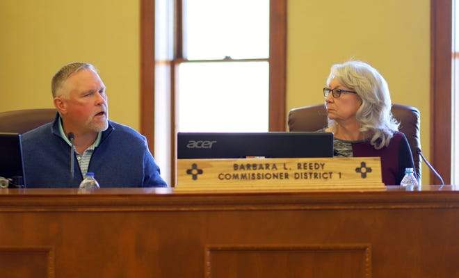 Luna County Manager Chris Brice fielded comments from the Board of Commissioners following Monday's passing of a Resolution 20-25 county-wide state of emergency which will enable the county to apply for state and federal funding during the COVID-19 (coronavirus) pandemic. District 1 Commissioner Barbara Reedy listens at right.
