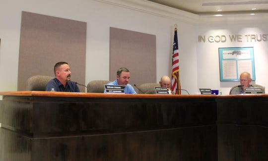 City Manager Brian Cesar speaks during the Alamogordo City Commission Emergency Meeting March 23. Also pictured are Alamogordo City Commissioner Jason Baldiwn, Commissioner Dusty Wright and Alamogordo Mayor Richard Boss.