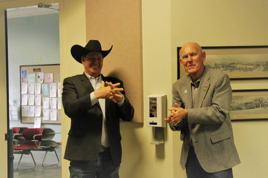 Alamogordo Chamber of Commerce Executive Director G.B. Oliver and Alamogordo Mayor Richard Boss use the hand sanitizing station inside the Alamogordo Commission Chambers following the City Commission Emergency Meeting March 23.