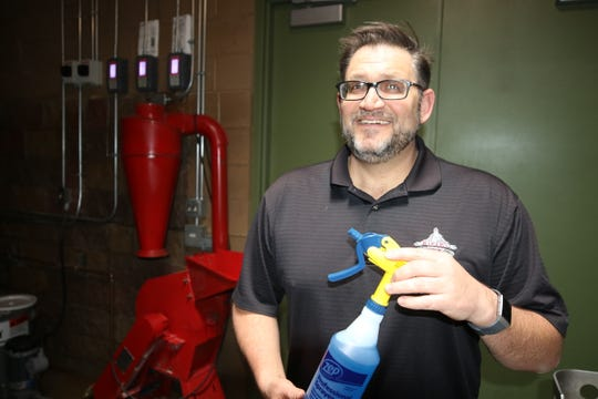 Dave Dailey, general manager of the Three Rivers Brewery, displays a bottle of the hand sanitizer the brewery has been manufacturing since last week.