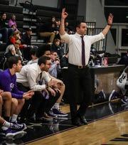 Bloomfield Hills junior-varsity coach Kal Riebau helps coach the varsity team.