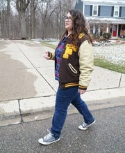 North Farmington High senior Emily Treger walks around her neighborhood on March 23, 2020. Treger often gets together with friends to go outside and break their homebound isolation during the COVD-19 outbreak.