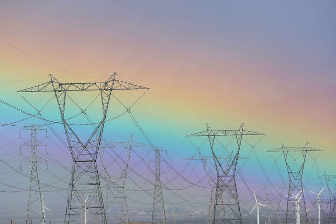 A rainbow colors the sky near power lines south of Desert Hot Springs, March 23, 2020. State leaders face a bit of a pickle in how they'll prevent rolling blackouts during high-demand periods as they continue to push toward decommissioning fossil fuel energy generation, Dan Walters writes.