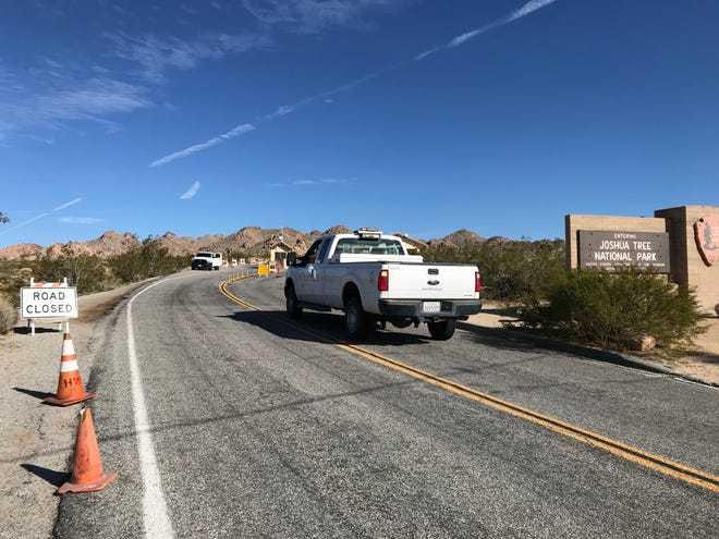 Cars parked wherever they could as rangers and county workers attempted to manage traffic at Joshua Tree National Park's West Entrance on March 22, 2020.