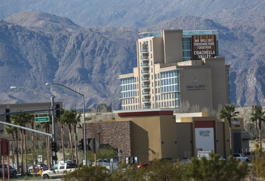 """An electronic billboard says """"We will get through this together Coachella Valley"""" on the Agua Caliente Casino in Rancho Mirage, March 23, 2020."""