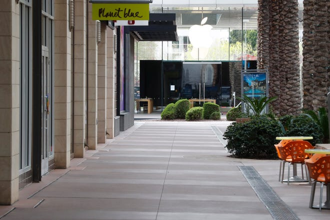 AFTER: Walkways are empty at the Scottsdale Quarter shopping mall on March 22, 2020.