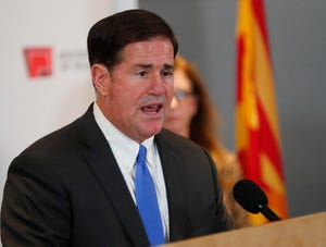 Gov. Doug Ducey gives an update on COVID-19 during a news conference at the Arizona State Public Health Laboratory in Phoenix March 23, 2020.