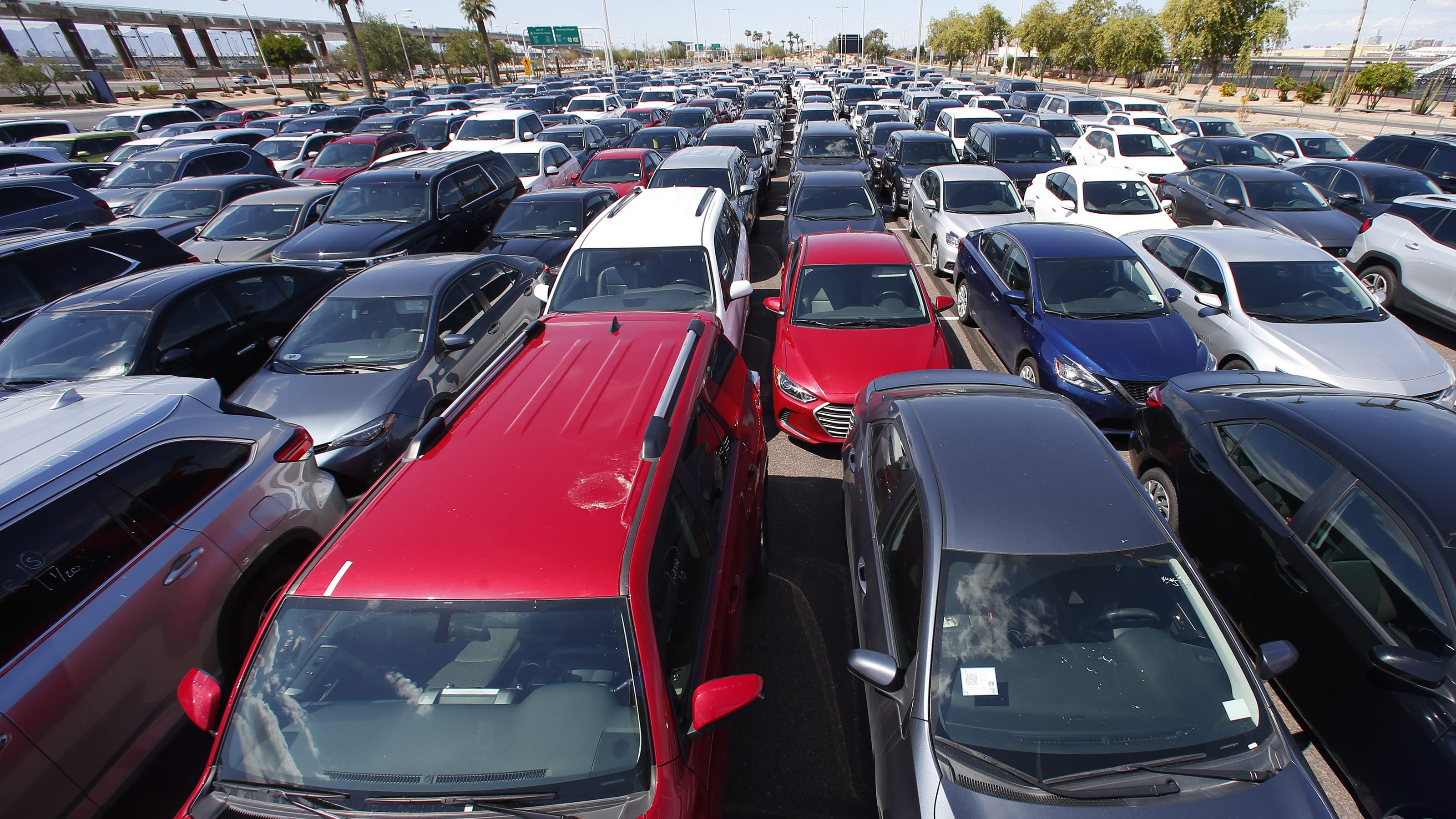 Coronavirus: Unused rental cars fill Phoenix airport parking lots