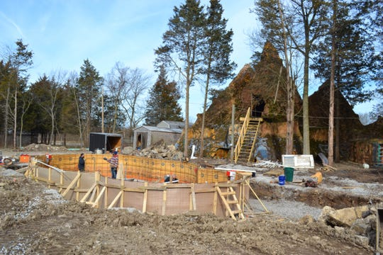 A crew works on the construction of the pool at the base of the backside of the mountain at Forest RV Park.