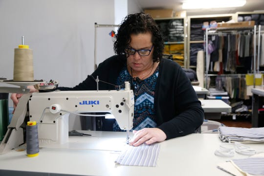 Unshattered seamstress & designer Jenn Kennedy sews a mask at Unshattered's production facility and showroom in Hopewell Junction on March 23, 2020.