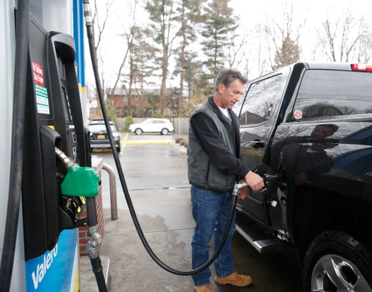 Paul Breitenbach pumps gas at the Valero in the Village of Wappingers Falls on March 23, 2020.