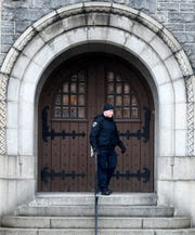 York City Police officer Michael Rykowski checks a door at the Gethsemane Building on North Beaver Street while on patrol Monday, March 23, 2020. He and other police, fire and property management representatives were checking that businesses, schools and organizations were complying with state and city Covid-19 closure orders. Bill Kalina photo