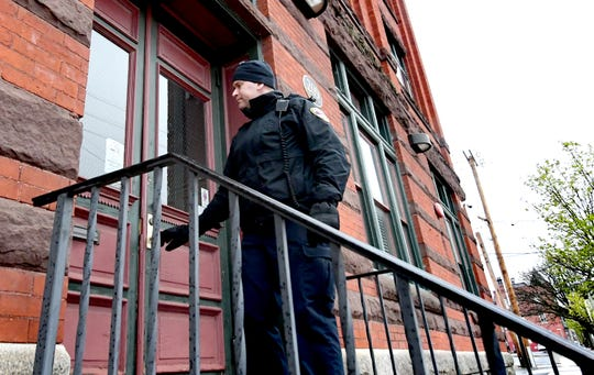 York City Police officer Michael Rykowski checks a locked door at a property on North Beaver Street while on patrol Monday, March 23, 2020. He and other police, fire and property management representatives were checking that businesses, schools and organizations were complying with state and city COVID-19 closure orders. Bill Kalina photo