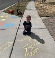 Colton Hanna,5, draws on the sidewalks in his Northwest REno neighborhood.