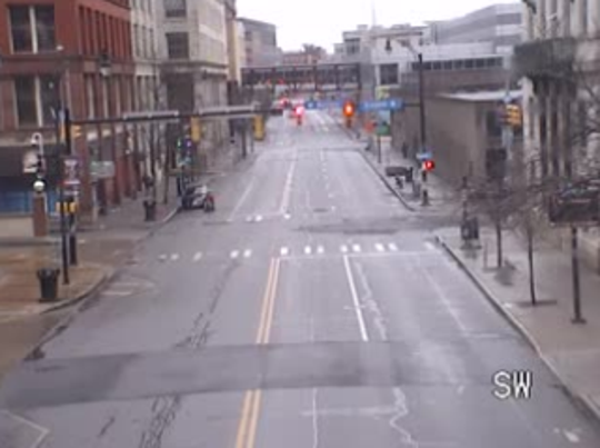 St Paul Street in Rochester, near Pleasant Street, is vacant around 8:15 a.m. Monday. The road is typically busy during the morning commute.