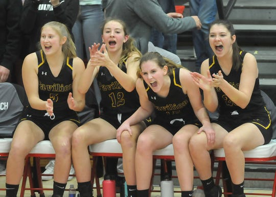 Players from Pavilion begin to celebrate as the Golden Gophers were on the verge of winning the Section V Class D1 title. The victory gave Pavilion its first sectional girls basketball championship since 1981.