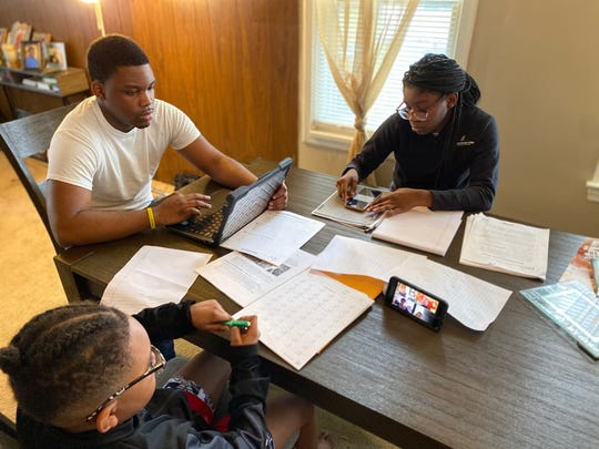 Doris Chavis' three younger children study at home while schools are closed due to COVID-19.