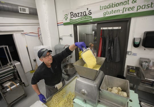 Michael Bozza makes fresh gnocchi at his Bozza Pasta shop in Hilton Monday, March 23, 2020. Due to the coronavirus pandemic closing restaurants across the state, the Bozza family decided to start a delivery service out of his Hilton shop to help get his products to customers, and to help stay in business.