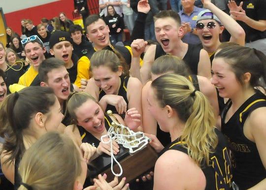 Members for the Pavilion Golden Gophers, including tournament MVP Karlee Zinkievich, celebrate with the Section V Class D1 trophy with fans after their win over Fillmore at Letchworth Central School.