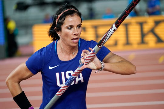Jenn Suhr, of the United States, warms up at the World Athletics Championships in Doha, Qatar, Sunday, Sept. 29, 2019. Suhr was training to compete in the Tokyo Olympics before the coronavirus pandemic struck.