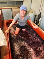 Haylee Oliver is shown working at a winery in France in this 2019 photo.