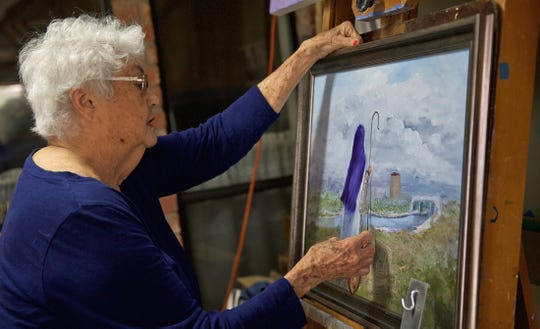 Barbara Jones works on a painting in her studio Monday, March 23, 2020.
