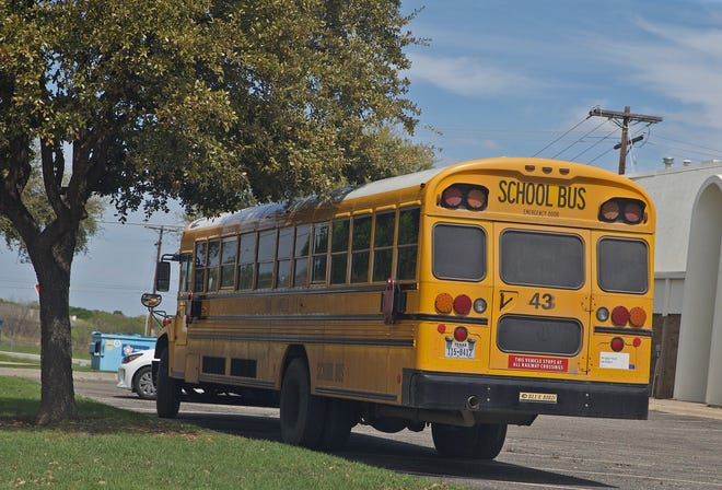 A bus parked at Southland Baptist Church by the San Angelo Independent School District is one of 23 providing free Wi-Fi to allow students to complete online school work Monday, March 23, 2020.