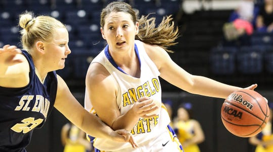 Angelo State sophomore Haylee Oliver drives past a St. Edward's defender during a game in 2012.