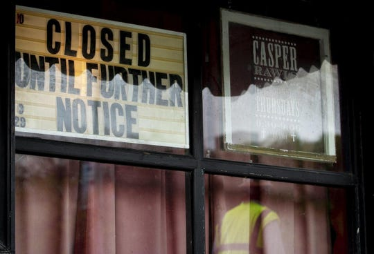 A sign in a window of the Continental Club notifies customers of its temporary closure Tuesday. The coronavirus has forced the temporary closing of several stores along South Congress Avenue, a popular retail and dining destination.