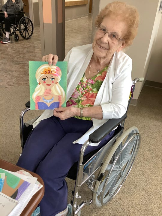 Jeanne Chambers poses with mail sent to Rocky Knoll to cheer up residents.