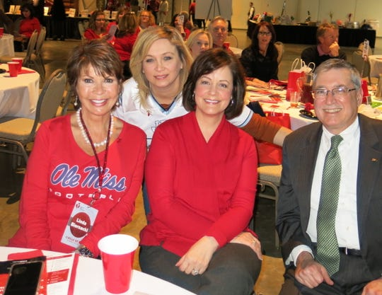 "Linda Biernacki, Ellen Ballard, Johnette Magner, Dr. Phillip Rozman at American Heart Association's ""Go Red for Women,"" with a theme which included ""Tailgating."""