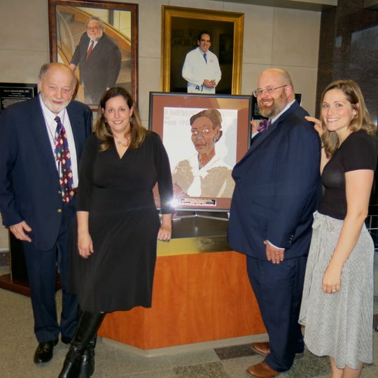 Dr. Dennis O'Callaghan, Army O'Callaghan and hubby Caddo Dist. Judge Brady O'Callaghan and Krista Gaston, official with Feist-Weiller Cancer Center at a reception celebrating the life of the late Artist Frances O'Callaghan.