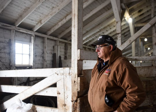 Walt Bones watches as cattle are moved onto a trailer on Saturday, March 21, 2020 in Parker, S.D. Although Bones kept an eye on the market and tried to implement risk management, he could not predict the impacts of the coronavirus.