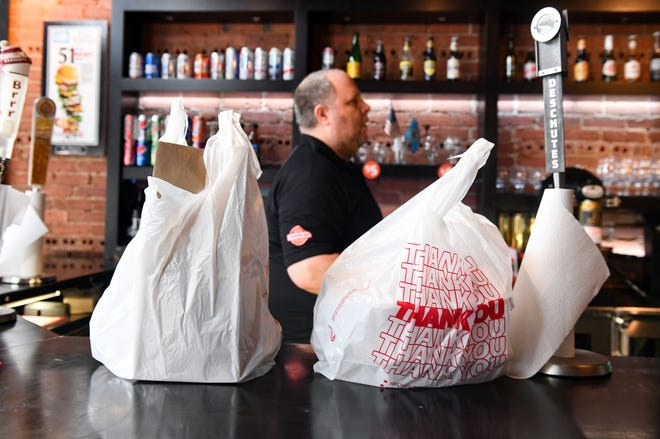 Carry-out orders sit waiting to be picked up on Monday, March 23, at JL Beers in Sioux Falls. Restaurants are offering to-go orders to encourage social distancing as coronavirus concerns grow.