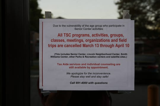 A sign on the door of the Tallahassee Senior Center explains activity cancellations due to COVID-19 safety precautions.