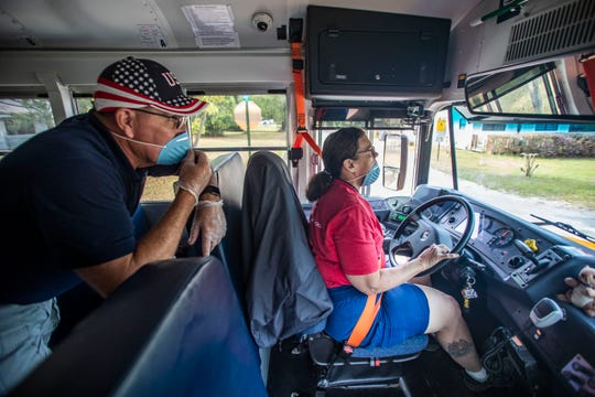 Wakulla County Schools Superintendent Robert Pearce keeps an eye out for students as bus driver Mary Youngblood drives a bus route, Monday, March 23, 2020.