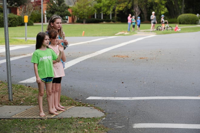 "Hawks Rise Elementary School families lined Meadow Ridge Drive in Ox Bottom neighborhood for a ""parade of smiles"" that allowed the students to see their teachers while school has been closed until April 15 due to the coronavirus pandemic Monday, March 23, 2020."