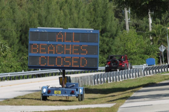 A Fort Pierce Police electronic sign is stationed along S.R. A1A on Hutchinson Island, informing drivers all public beach access points in St. Lucie County are closed to help prevent the spread of the COVID-19 virus on Monday, March 23, 2020, in Fort Pierce.
